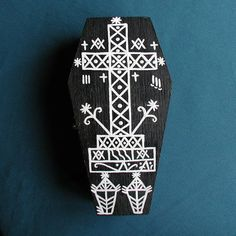 Wood coffin box handpainted with the veve for Baron Samedi. He is a very powerful Guede loa who controls passage between the world of the living &