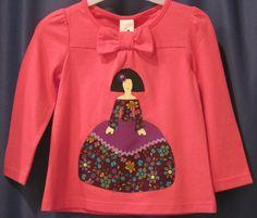 Samarreta vermella èstil clàssic amb pachwork  de cortesa. L´èstil clàssic també té lloc a marta colors. $24.90