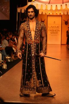 You don't find models casually carrying swords down the runway in the U.S....Fashion Week, India