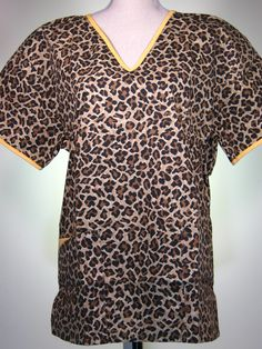 #caringplus scrub top - Leopard print, brown - CaringPlus scrubs and uniforms - workwear clothing for nurses, caregivers and other healthcare professionals.  Perfect apparel for doctor's, dental and optician offices, nursing homes, rehab centers, vet clinics, animal hospitals, or medical labs.