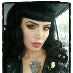 pinup look. love the straight bangs.