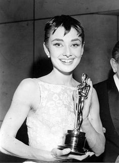"""Actress Audrey Hepburn poses with her Oscar statuette at the annual Academy Awards presentations in New York, on March 24, 1954. Hepburn was awarded best actress for her only first movie starring role, the portrayal of a free-spirited Princess in the motion picture """"Roman Holiday.""""  (AP Photo)"""