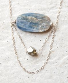 kyanite. I love it when the crystal structure is visible / Coastal no. 3 - a kyanite and pyrite necklace. $85.00, via Etsy.