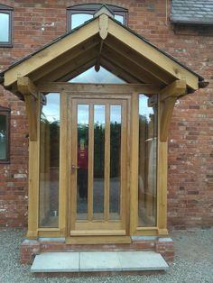 Front on view of our Eyton oak framed porch. Supplied and fitted by Wye Oak. Porch Uk, House Front Porch, Front Porch Design, Front Porches, Glazed External Doors, External Oak Doors, Door Canopy Porch, Porch Doors, Porch With Canopy