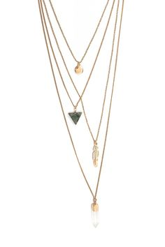 A high-polish layered necklace featuring a flat round pendant, an etched feather pendant, a geo faux stone pendant, a faux crystal pendant with a contrast base, and lobster clasp closure.