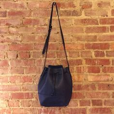 "J.Crew navy bucket bag J.Crew leather navy bucket bag 13"" wide x 10"" deep with a strap that can adjust from a 16"" drop to a 21"" drop, worn once. J. Crew Bags Crossbody Bags"