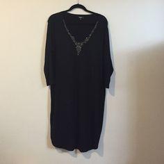 Black cotton dress with bead detailing Black dress with bead detailing by the v-neck. Never been worn. NWOT Dresses