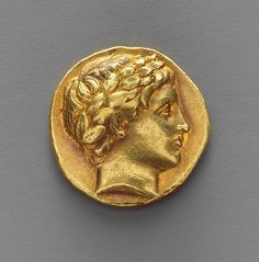 Gold stater. Gold coins of this type were minted for over forty years at the two principal royal mints in Macedon, Pella and Amphipolis. The trident and details of the horses' legs on this coin indicate that it was minted at Amphipolis in the years immediately after the death of Alexander the Great.     Early Hellenistic  Date:     ca. 323/2–315 B.C.