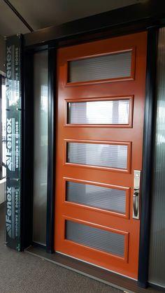 oversized orange front door with modern glass inserts Ottawa, Entrance Doors, Garage Doors, Orange Front Doors, Front Door Design, Modern Door, Modern Glass, My House, Modern Design
