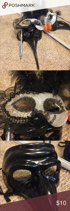 Set of Two Masquerade Masks Brand new set of Masquerade masks! Never worn! They've just been sitting in my closet. One is for a woman in the Colombina style and has a silver handle with lace, glitter, embellishments and feathers. The other is for a man to wear. It's all black with a satin ribbon closure in the Zanni style of Ventian masks. Perfect set for a couple! Great for Halloween or New Year's! Other