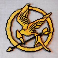 The Hunger Games perler beads by thepixel_artstore