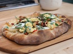 Tarte Flambe with Herbed Creme Fraiche, Aged Cheddar, Caramelized Vidalia, Double Smoked Bacon, Softly Scrambled Eggs and Goat Cheese