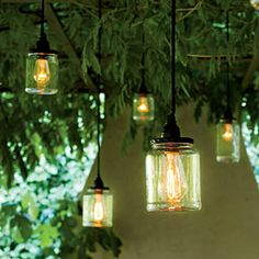 Shed New Light on Canning Jars: Peel off the labels of pickle and okra jars, and use a cord kit to illuminate each one. Equipped with a dimmer and hung at varying heights, they provide the ideal mix of rustic and industrial.