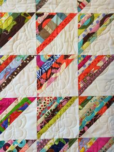 String pieced half square triangles - another great scrap quilt! So simple yet cute and not too busy. Great use of scraps.