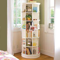 OMG revolving bookcase- such a good idea for a corner space!!