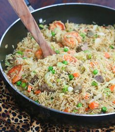 Fried Rice African Style. Spiced with garlic, thyme, and curry. Big on taste!