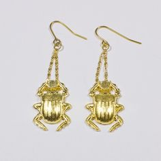 Gold beatle earrings