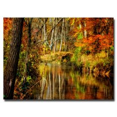 This piece of landscape canvas art will bring the colorful beauty of fall into your home all year long. The autumn trees reflected in a streem will create a peaceful atmosphere in any room. Measuring 22' x 32', it is perfect for a medium sized wall.