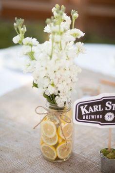 summer table settings: burlap, lemons, white flowers, mason jars.