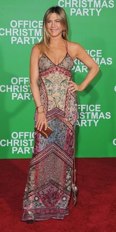 For the Office Christmas Party premiere Jennifer Aniston got in the festive spirit when she arrived not in her signature sleek LBD's, but in a colourful Roberto Cavalli tulle gown featuring multicoloured bead, stone, and crystal embroideries in a Victorian motif. To round out her bohemian-chic aesthetic, she finished her look with gold chandelier earrings, a stack of delicate bangles, and metallic clutch.
