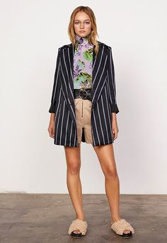 Model wearing a lilac floral top and pinstripe blazer | ASOS Fashion & Beauty Feed
