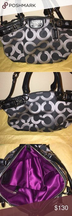 Navy Blue & Silver Coach Purse This elegant navy and silver Coach Purse is great even on a casual jean day. In excellent condition, work only less than a handful of times. You can carry this elegant purse on your arm or use the shoulder straps. Purse size 14x9 Coach Bags Shoulder Bags