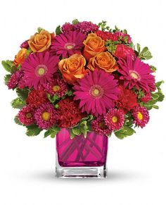 Turn Up The Pink Bouquet $43 orange roses, hot pink gerberas, carnations and matsumoto asters are accented with bupleurum and variegated pittosporum.