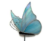 Butterfly Garden Stake Stained Glass by Nostalgianmore, $75.00 Available in your choice of colors!  Sweet!