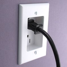 Leviton Recessed Power Outlet - for those weird spaces behind furniture you want up against a wall or power cables for wall mounted electronics (no more ugly power cords hanging down!)