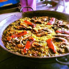 Eat Paella in Spain.