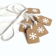"15 - 7/8"" x 13/16"" Tiny White Snowflake, Kraft Brown Holiday Gift Tags or Ornaments, Made Using Repurposed, Recycled Materials, Hand Punched"