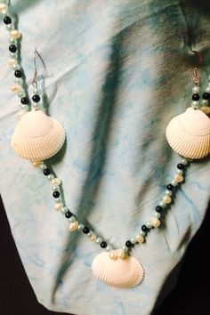 Pearl beads with cockle shell. Earrings are exact match and hooks have hypoallergenic coating