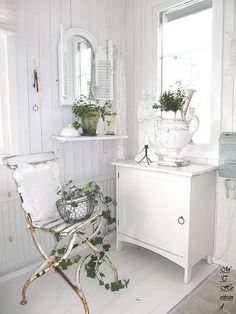 plant by window in guest bath....on little white shabby chic table I already have. Love the ironstone in this bath and the chippy chair