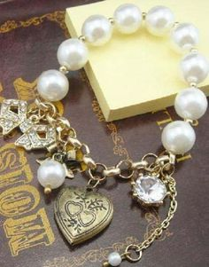 Gold Pearls Bow Heart Bracelet pictures