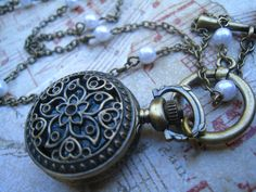 VICTORIAN Tiny Miniature Working Pocket Watch, Glass Pearls, Antique Brass Chain, by DelightAndRage, via Etsy.