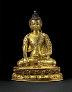 Gilt bronze Buddha image, Tibet, 15th century. Stylistically, the distinctively rounded face with refined features, including a small bow-shaped mouth and heavy-lidded eyes, and the distinctive drapery of the robe which turns back on itself at the border as it drapes under the right arm and back up over the shoulders suggest a possible connection with the Densatil monastery which was founded in 12th century Tibet.
