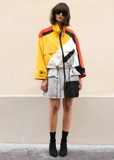"""#newarrivals #sportychic #colorblock #thefrankieshop #frankienyc #frankiegirl Batwing Sleeve Jacket w/2 Front Pockets & Drawstring Waist. Oversized Fit High Neck Zip Closure (Can be worn as a dress or jacket) Abstract Design Color- Red, White, Yellow, Black & Grey 100% Poly 38"""" Length, 24.5"""" Width Dry Clean Imported"""