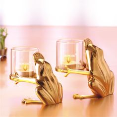 Presenting Borosil Froggy Tea-light, designed to bring prosperity and positive energy in your home. Handcrafted in brass, these cute golden pair of frogs holds borosillicate tea lights, which can burn for hours without the fear of cracking. #Tealights #HomeDecor