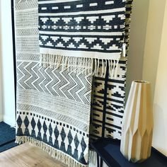 Inka black & white rug over Large natural block print rug 230 x 160 cm by House Doctor http://www.rossandbrownhome.co.uk/home-accessories/rugs-mats.html