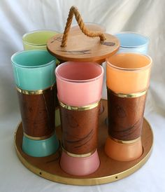 vintage hawaiian tiki tumblers with wooden carrier, on Etsy - I would love to have something like this.