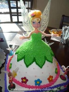 Homemade Tinkerbell Cake: I made this Tinkerbell Cake for my daughter's fourth birthday. I used the Wilton's dress pan for the Tinkerbell dress, however the doll was too tall so