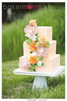 Peach Three-Tier Wedding Cake with Floral Strand Decoration