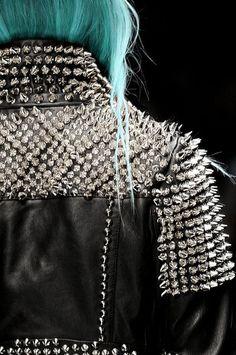 turquoise hair, studded black leather jacket