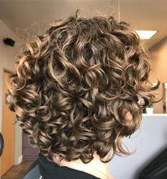 """Dark-Blonde Short Curly Hairstyle Bronde hair colors are great in-between shades that don't require too much commitment or maintenance. Pairing this hairdo with bangs and """"wet"""" styling for wavy hair is sure to turn heads. Curly Hair Styles, Haircuts For Curly Hair, Short Wavy Hair, Curly Hair Cuts, Curly Bob Hairstyles, Long Curly, Natural Hair Styles, Hairstyles 2018, Short Haircuts"""