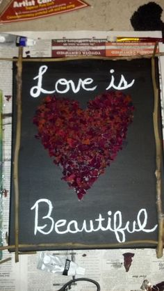 My finished project. The heart is made from crushed up dried rose petals and then used the stems on the sides.