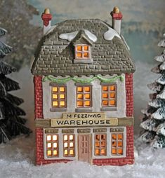 Christmas Department 56 Fezziwig Warehouse. Dickens Series Collectible Hand Painted Porcelain Warehouse. Xmas Village Building with Lights. It is hand painted and has many beautiful details. Comes with light kit. Excellent vintage condition. Marked by manufacturer. It has an