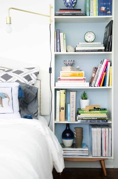 would be cool to make Ella a book case like this...Mid-century bookcase with brass swing-arm sconce in a modern bedroom.