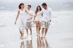Good looking family with teens walking and talking on the beach at Santa Monica Ca Stock Photo