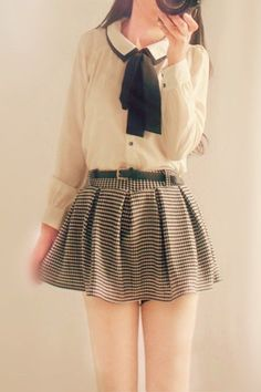 White blouse and grey skirt
