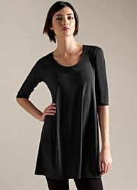 I live in Eileen Fisher.  Comfy stuff, stands up to everyday wear, always looks fresh and packs well too.